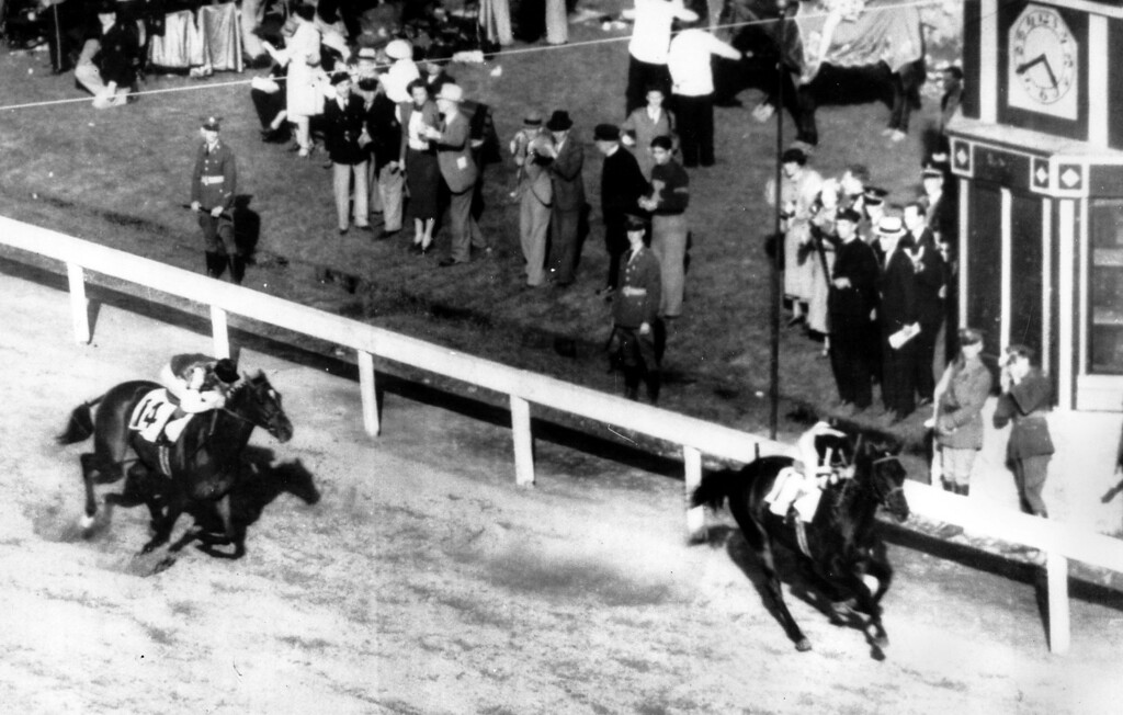 . 1937:  WAR ADMIRAL - War Admiral wins the Kentucky Derby two lengths ahead of his challenger, Pompoon, at Churchill Downs in Louisville, Ky. in 1937.  The speedy son of Man o\' War won after asserting his superiority early in the race.  (AP Photo)