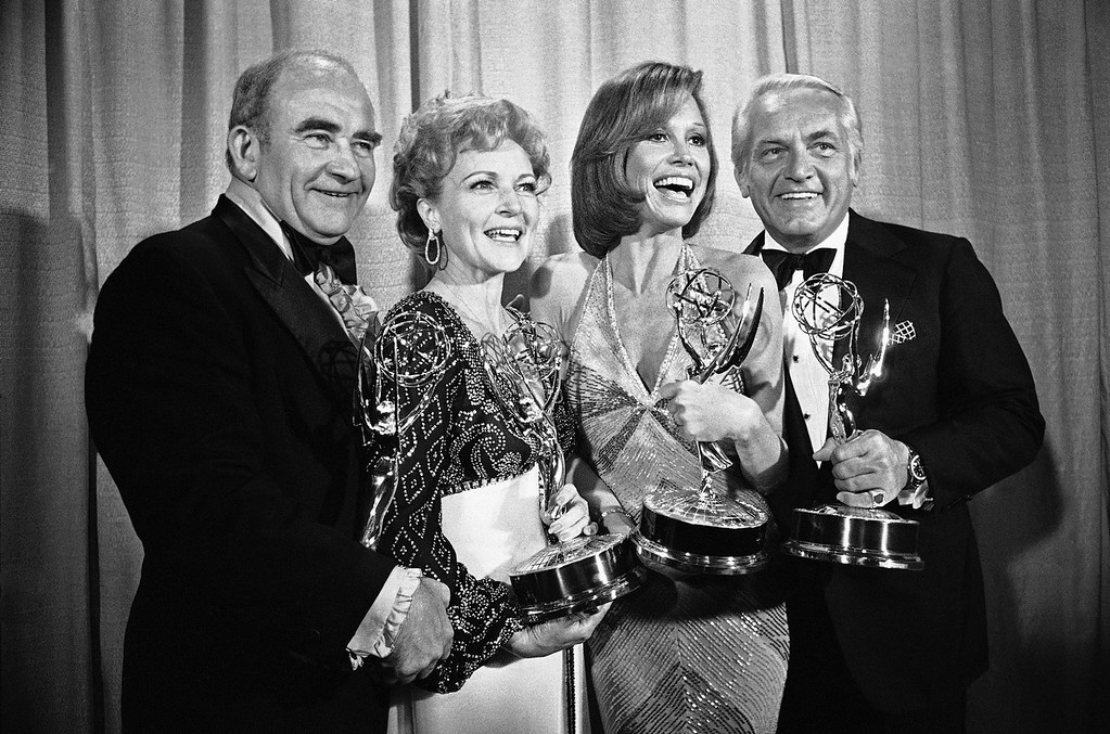 ". Members of the ìMary Tyler Moore Showî pose with their Emmys backstage, Monday, May 18, 1976 at the 28th annual Emmy Awards in Los Angeles. From left are, Ed Asner, who plays the news director on the show but won his Emmy for his role in ìRich Man Poor Man""; Betty White, supporting actress; Ms. Moore for best actress in a comedy show and Ted Knight for supporting actor. (AP Photo/Reed Saxon)"