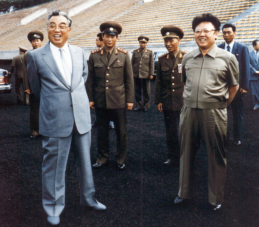 . Photo taken in 1992 shows North Korean leader Kim Jong-Il (R) and then-leader, Jong-il\'s father, Kim Il-Sung (L) inspecting a soccer ground in Pyongyang. Kim Jong-Il was named General Secretary of the ruling Workers Party 08 October, one of two top posts left vacant since the death of the elder Kim in 1994. (AFP/Getty Images)