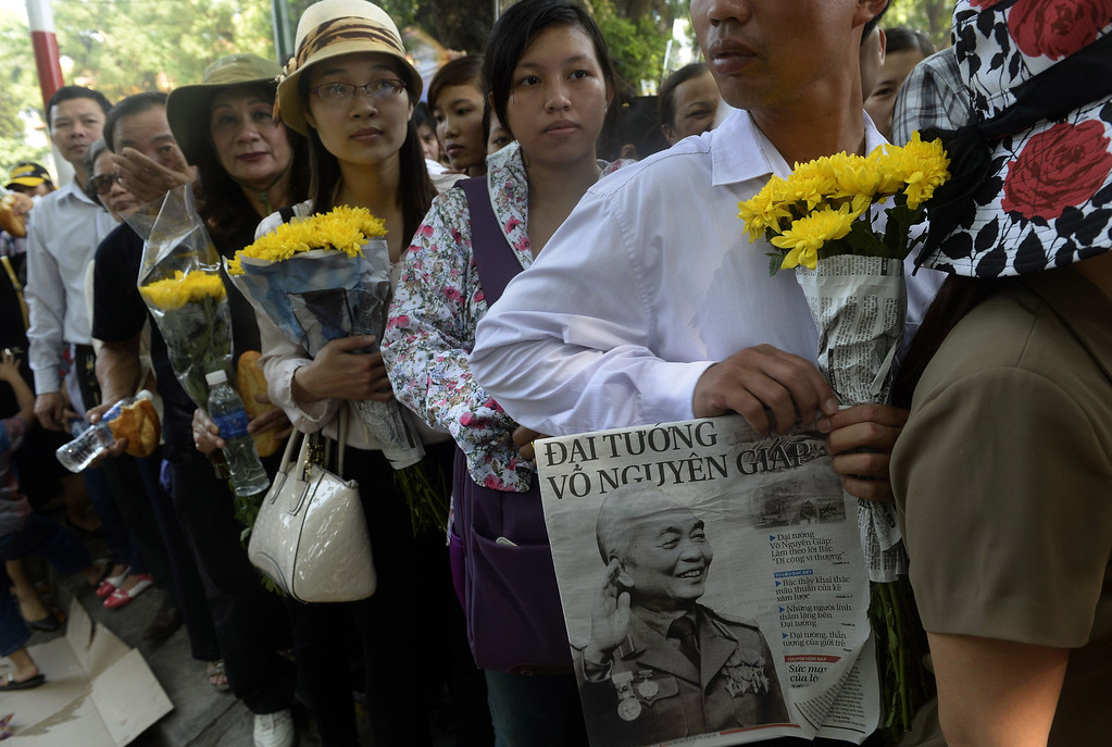 . People line up on a street leading to the late General Vo Nguyen Giap\'s house to pay their respects in Hanoi on October 9, 2013. Thousands of mourners gathered outside the home of Vietnam\'s revered General Vo Nguyen Giap to pay their last respects to the wildly-popular independence hero.  HOANG DINH NAM/AFP/Getty Images