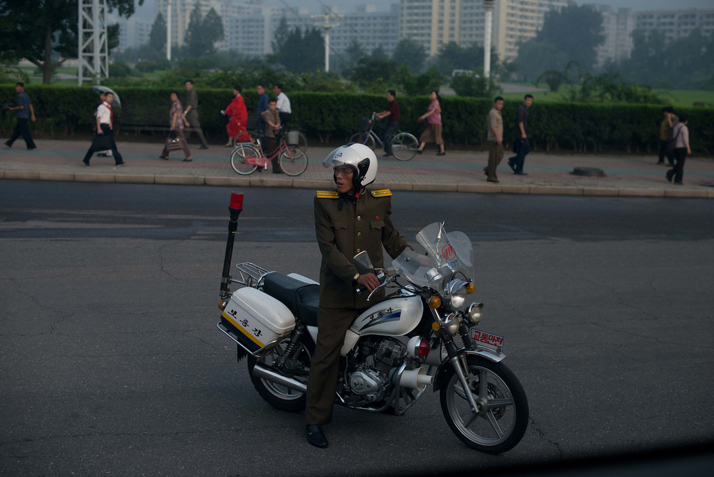 . A policeman directs traffic in Pyongyang on July 25, 2013. North Korea is preparing to mark the 60th anniversary of the end of the Korean War which ran from 1950 to 1953, with a series of performances, festivals, and cultural events culminating with a large military parade taking place on July 27. AFP PHOTO / Ed JonesEd Jones/AFP/Getty Images