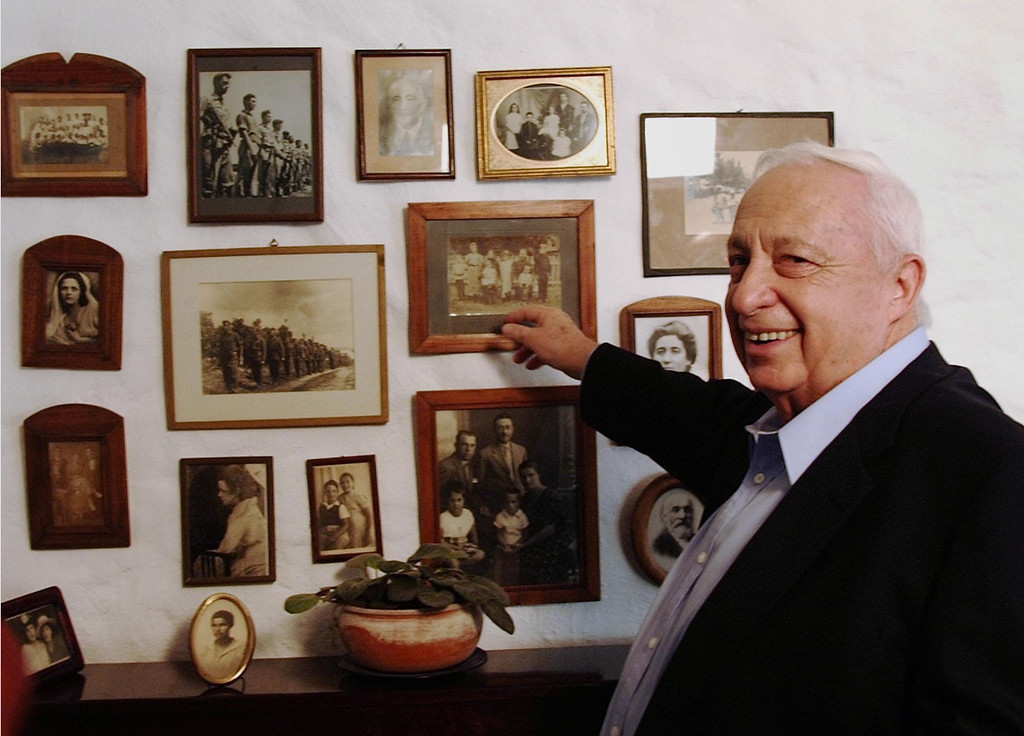 . In this handout provided by the Israeli Governmental Press Office, Israeli Prime Minister Ariel Sharon points to family photos at his home August 3, 2001 at Shilmim Ranch in southern Israel.  (Photo by Moshe Milner/GPO via Getty Images)