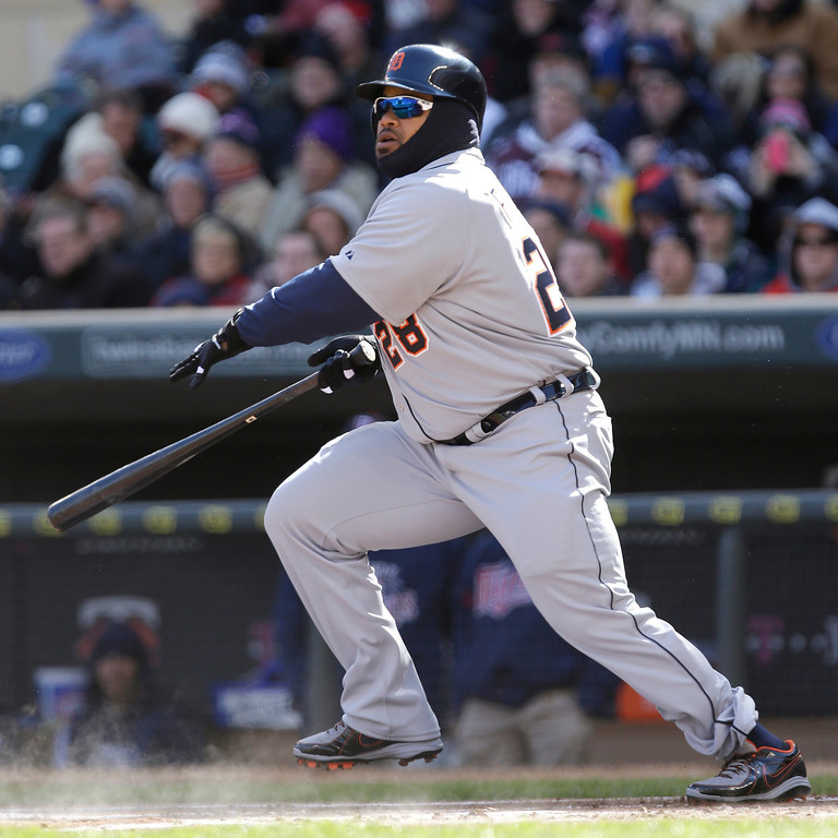 . Detroit Tigers\' Prince Fielder hits a double in the first inning of  an opening day baseball game against the Minnesota Twins\' Monday, April 1, 2013 in Minneapolis. (AP Photo/Jim Mone)