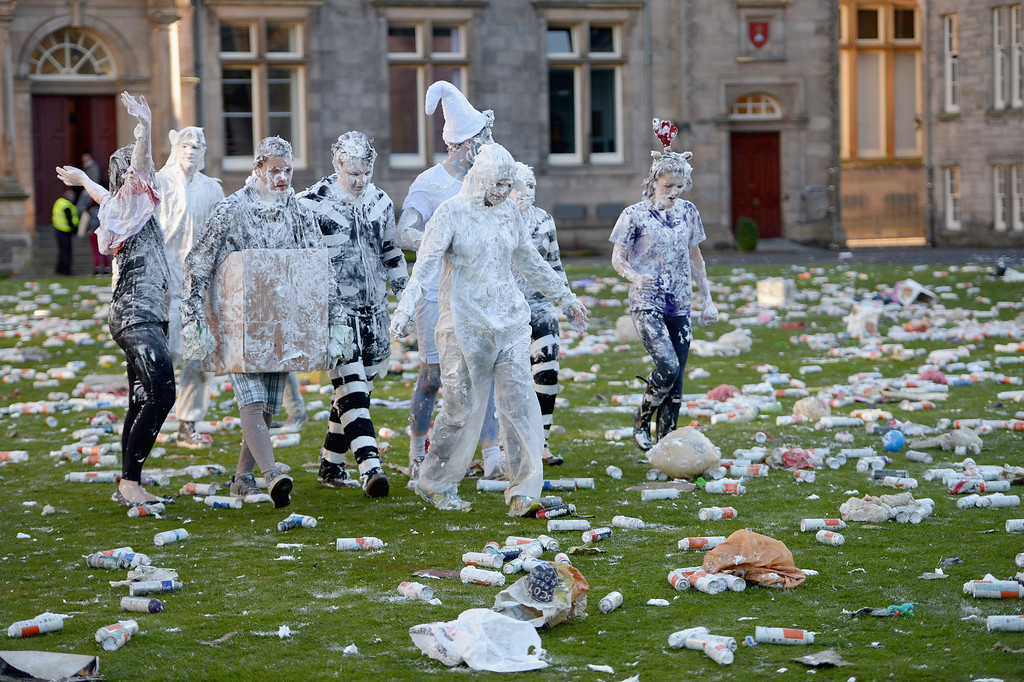 . Students from St Andrew\'s University indulge in a tradition of covering themselves with foam to honor the \'academic family\' on November 4, 2013, in St Andrews, Scotland. Every November the \'raisin weekend\' which is held in the university\'s St Salvator\'s Quadrangle, is celebrated and a gift of raisins (now foam) is traditionally given by first year students to their elders as a thank you for their guidance and in exchange they receive a receipt in Latin.  (Photo by Jeff J Mitchell/Getty Images)