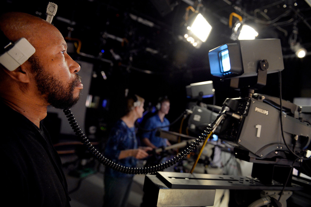 . AURORA, CO. - FEBRUARY 18: Volunteer Deleno Austin works on a camera during the taping of Aurora News Weekly in Aurora, CO February 18, 2014. The 30 minute news show is part of Aurora 8\'s public access programming. (Photo By Craig F. Walker / The Denver Post)