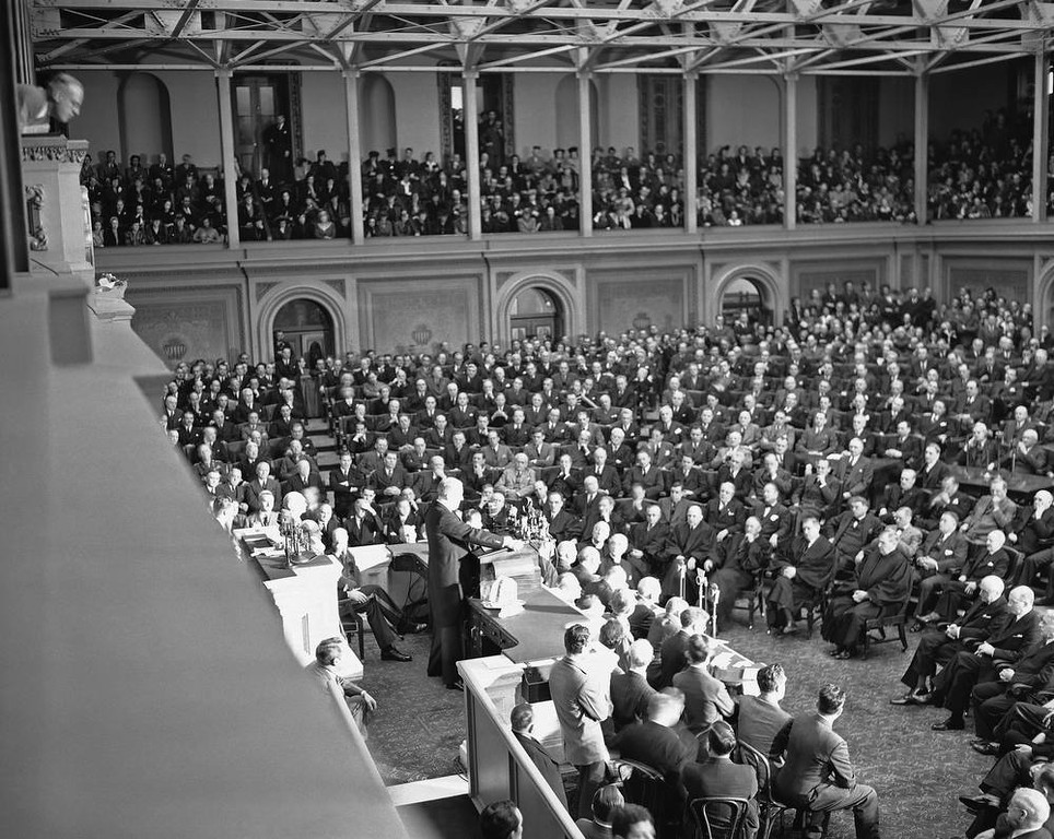 ". Tense faces of Congressmen, cabinet members, Supreme Court justices, crowded galleries looked to a grim President Franklin D. Roosevelt as he asked for war against Japan, said: ""With confidence in our armed forces - with the unbounding determination of our people - we will gain the inevitable triumph - so help us, God.\""  President Roosevelt spoke in the House of Representatives, addressing a joint session of Congress, Dec. 8, 1941. (AP Photo)"