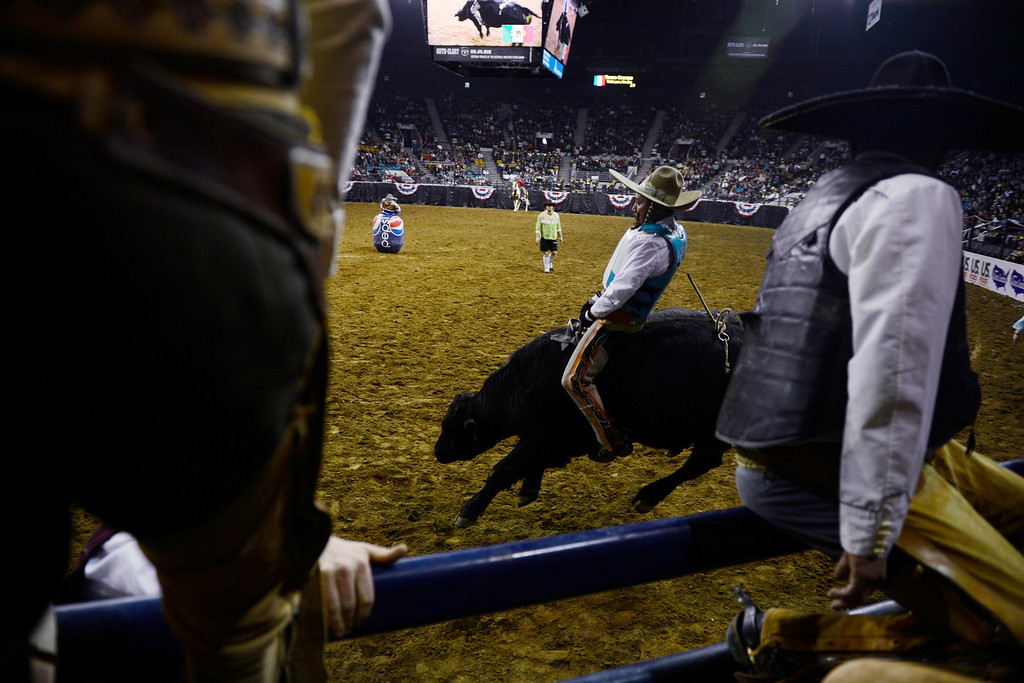 . A bull rider takes the arena floor during National Western Stock Show\'s Mexican Rodeo Extravaganza at the Denver Coliseum on Sunday, Jan. 13, 2013. AAron Ontiveroz, The Denver Post