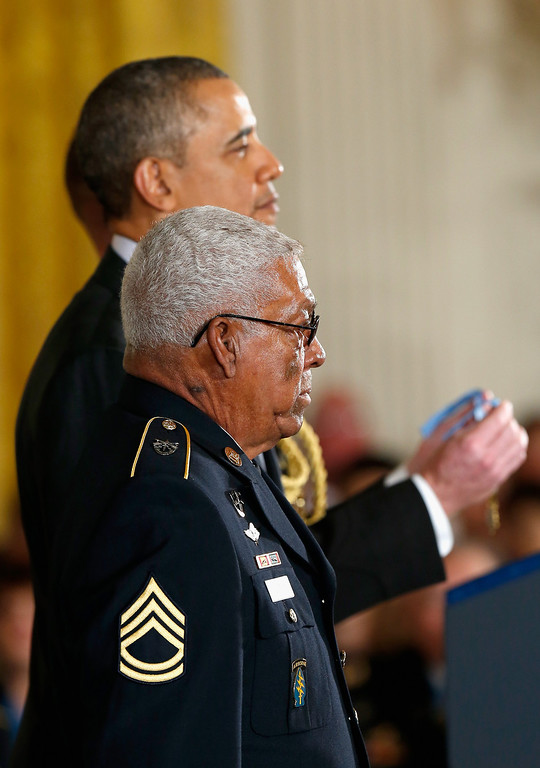 . U.S. Army Staff Sgt. (Ret.) Melvin Morris, (front) a Vietnam War veteran, is awarded the Medal of Honor from U.S. President Barack Obama at the White House on March 18, 2014 in Washington, DC.  Melvin Morris, U.S. Army Sgt. First Class (Ret.) Jose Rodela and U.S. Army Specialist Four (Ret.) Santiago J. Erevia were joined by the families of 21 others who were presented posthumously with the Medal of Honor.   (Photo by Win McNamee/Getty Images)