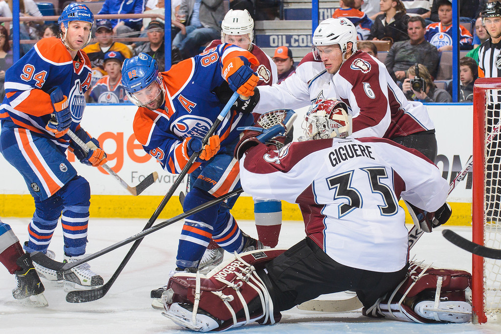 . Sam Gagner #89 of the Edmonton Oilers takes a shot on Jean-Sebastien Giguere #35 of the Colorado Avalanche during an NHL game at Rexall Place on April 8, 2014 in Edmonton, Alberta, Canada. (Photo by Derek Leung/Getty Images)