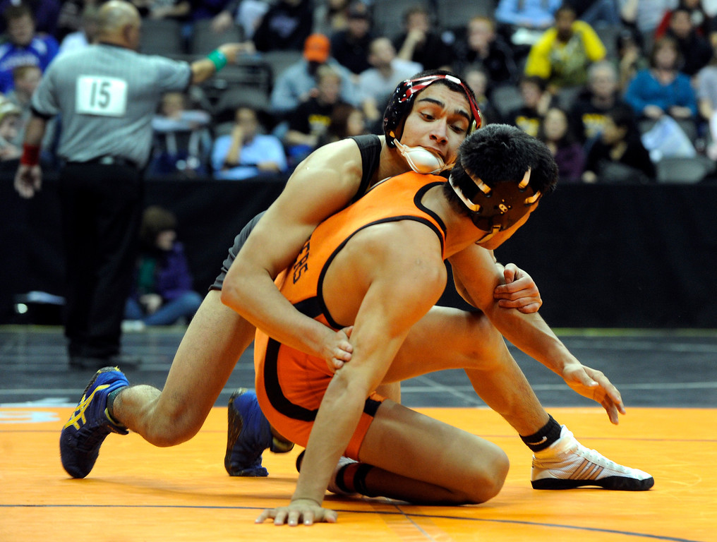 . DENVER, CO. - FEBRUARY 21: Rocky Mountain sophomore Roman Ortiz, left, went after Grand Junction opponent Louis Guillen, right, during a 138-pound bout in class 5A Thursday night. The CHSAA State Wrestling Tournament kicked off Thursday, February 21, 2013 at the Pepsi Center in Denver. (Photo By Karl Gehring/The Denver Post)