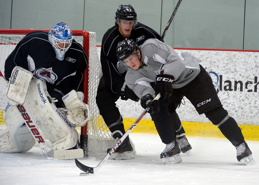 . Colorado Avalanche C Nathan MacKinnon (29) tries to get a shot off as Colorado Avalanche D Mason Geertsen (65) come up on defense during practice September 10, 2013 at Family Sports. (Photo By John Leyba/The Denver Post)