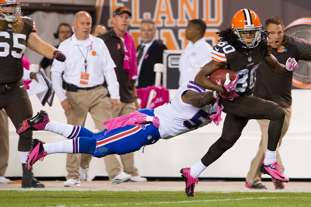 . CLEVELAND, OH - OCTOBER 03: Outside linebacker Nigel Bradham #53 of the Buffalo Bills misses the tackle on wide receiver Travis Benjamin #80 of the Cleveland Browns as Benjamin goes on to return a punt for a touchdown during the first half at FirstEnergy Stadium on October 3, 2013 in Cleveland, Ohio. (Photo by Jason Miller/Getty Images)