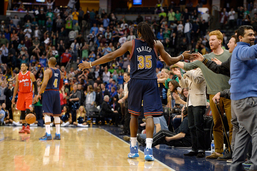 . Denver Nuggets forward Kenneth Faried (35) high fives the crowd after their win over the Los Angeles Clippers 110-100 March 17, 2014 at Pepsi Center. (Photo by John Leyba/The Denver Post)
