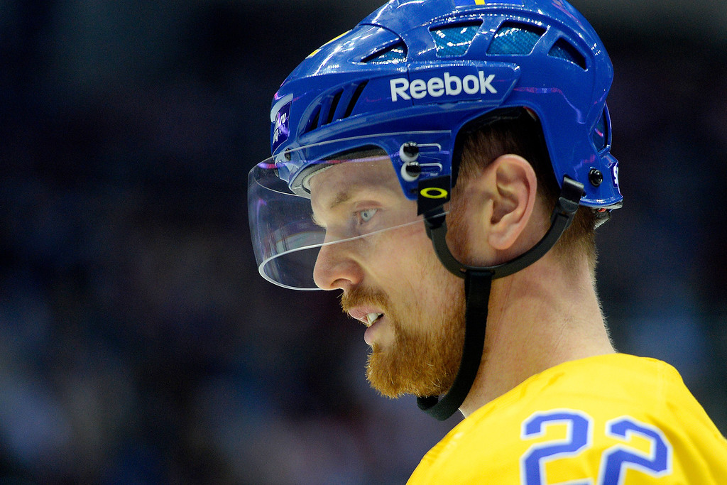 . Sweden\'s Daniel Sedin takes a breather against Switzerland during the action at Bolshoy Arena. Sochi 2014 Winter Olympics on Friday, February 14, 2014. (Photo by AAron Ontiveroz/The Denver Post)