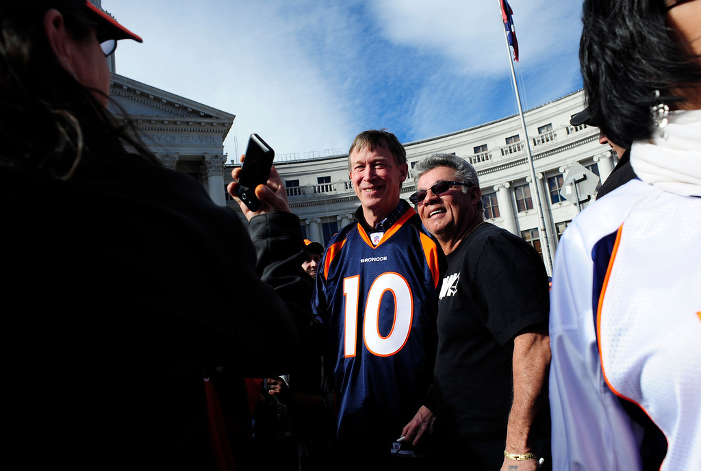 . Governor John Hickenlooper stands for a picture with Gabriel Trujillo, of Denver, during a rally to send off the Denver Broncos, at the City and County Building in Denver, Colorado, Sunday, January 26, 2014. The noon rally brought out scores of supporters and included an appearance by Governor John Hickenlooper and Denver Mayor Michael Hancock.  (Photo By Brenden Neville / Special to The Denver Post)
