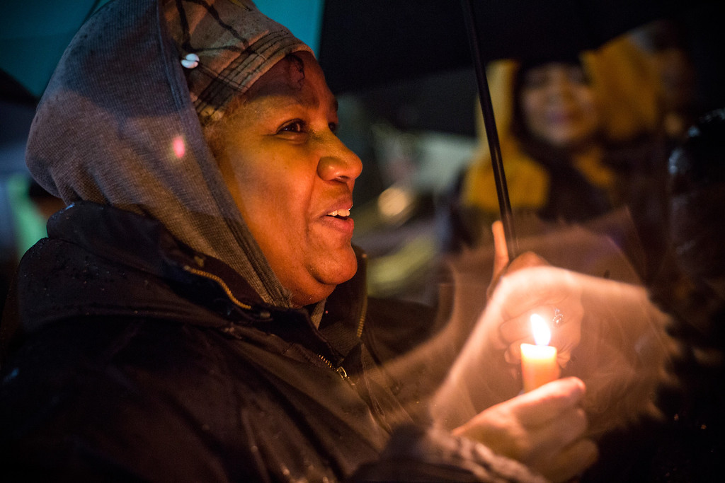 . A woman attends a candle lit vigil outside the South African Consulate, held in memory of South Africa\'s former leader and leader against Apartheid, Nelson Mandela, who died yesterday, on December 6, 2013 in New York, United States. Mandela was a leader that helped conquer apartheid in racially divided South Africa after being jailed for his activism for decades. He was South Africa\'s first black president; he lived from 1918-2013.  (Photo by Andrew Burton/Getty Images)