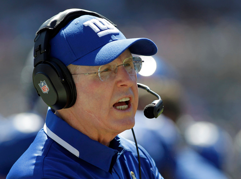. New York Giants head coach Tom Coughlin looks on during the first half of an NFL football game against the Carolina Panthers in Charlotte, N.C., Sunday, Sept. 22, 2013. (AP Photo/Bob Leverone)