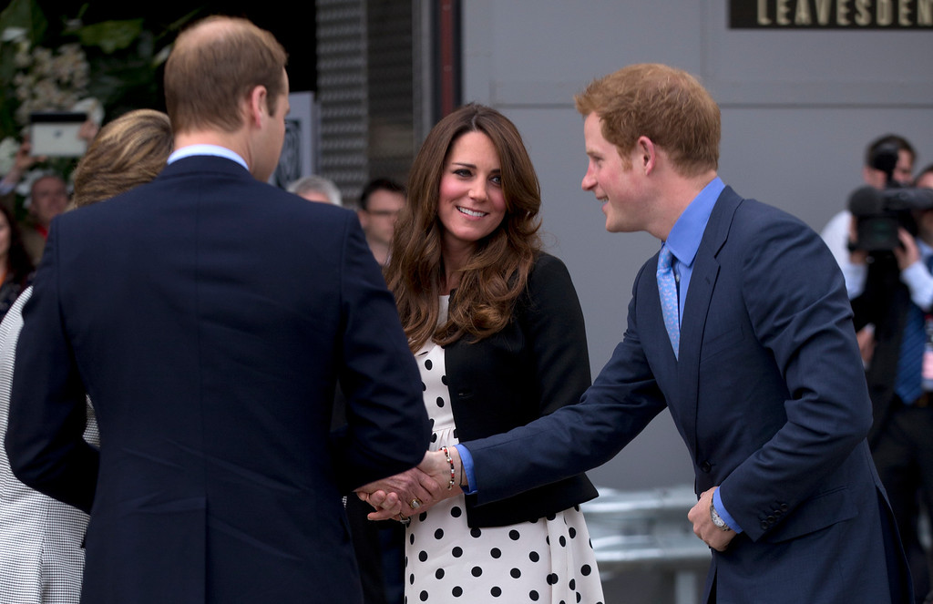 """. Britain\'s Kate the Duchess of Cambridge stands with her husband Prince William, left, and his brother Prince Harry, right, as they are greeted upon their arrival to attend the inauguration of \""""Warner Bros. Studios Leavesden\"""" near Watford, approximately 18 miles north west of central London, Friday, April 26, 2013. (AP Photo/Matt Dunham)"""