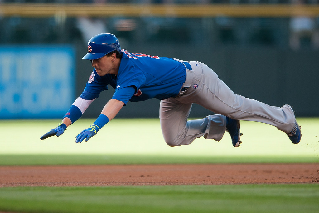 . DENVER, CO - AUGUST 06:  Chris Coghlan #8 of the Chicago Cubs slides head first into third base with a leadoff triple against the Colorado Rockies at Coors Field on August 6, 2014 in Denver, Colorado.  (Photo by Dustin Bradford/Getty Images)