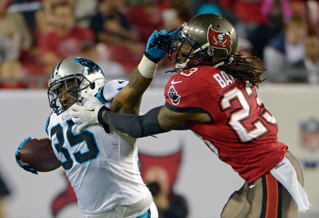 . Carolina Panthers fullback Mike Tolbert (35) is called for a face mask penalty as he tries to get past Tampa Bay Buccaneers strong safety Mark Barron (23) during the first half of an NFL football game in Tampa, Fla., Thursday, Oct. 24, 2013. (AP Photo/Phelan M. Ebenhack)