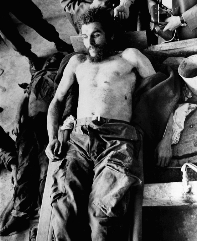 """. Cuban revolutionary and former right hand man of Fidel Castro, Ernesto \""""Che\"""" Guevara\'s body is seen in Oct. 1967 after he was shot to death in Bolivia. (AP Photo)"""