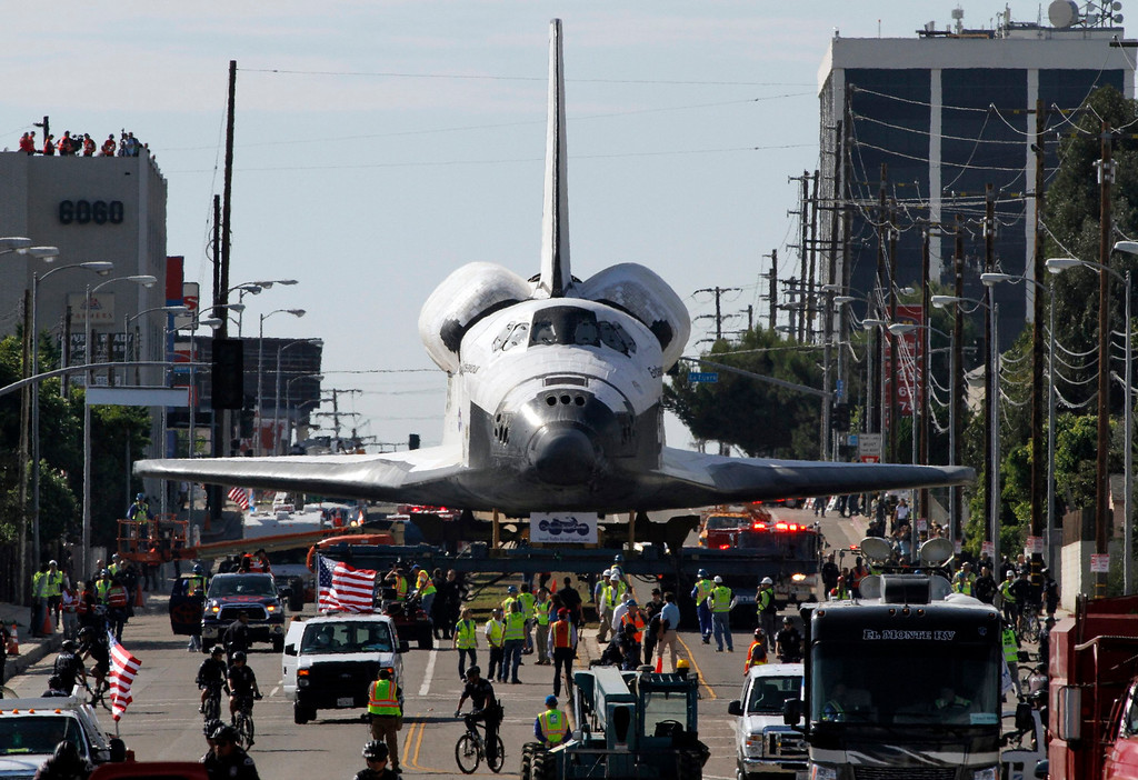 . Space Shuttle Endeavour is transported on Manchester Avenue while being moved from Los Angeles International Airport to its retirement home at the California Science Center in Exposition Park in Los Angeles, California October 12, 2012. REUTERS/Jonathan Alcorn