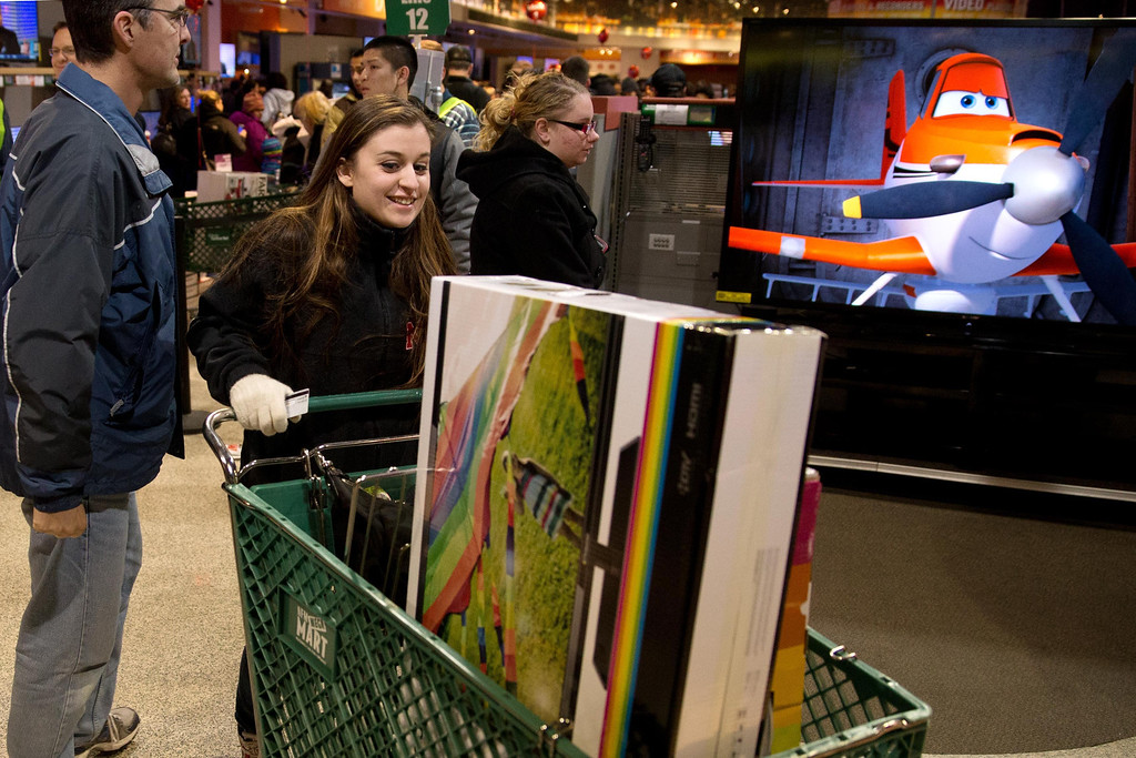 . Brittny King shops at the Nebraska Furniture Mart in Omaha Neb.,  on Friday, Nov. 29, 2013. Black Friday, the day after Thanksgiving, is the nation\'s biggest shopping day of the year. (AP Photo/The Omaha World-Herald/Jm Burnett)