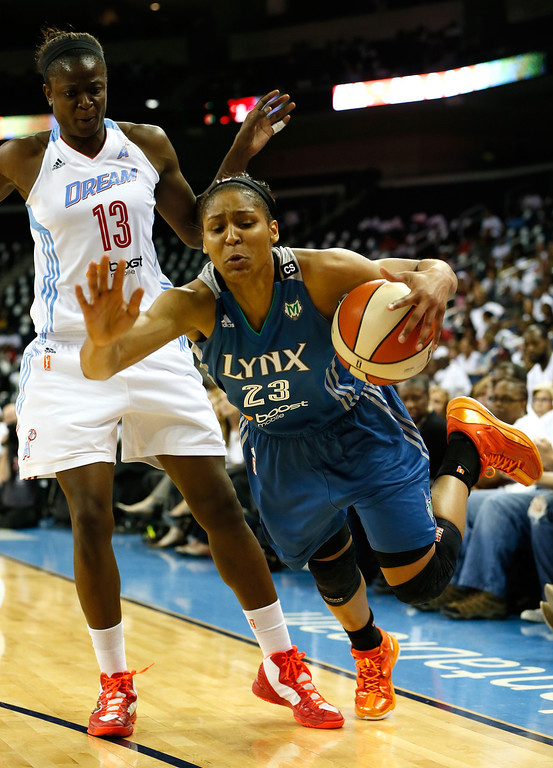 . ATLANTA, GA - OCTOBER 10:  Maya Moore #23 of the Minnesota Lynx draws a foul from Aneika Henry #13 of the Atlanta Dream during Game Three of the 2013 WNBA Finals at Philips Arena on October 10, 2013 in Atlanta, Georgia.   (Photo by Kevin C. Cox/Getty Images)