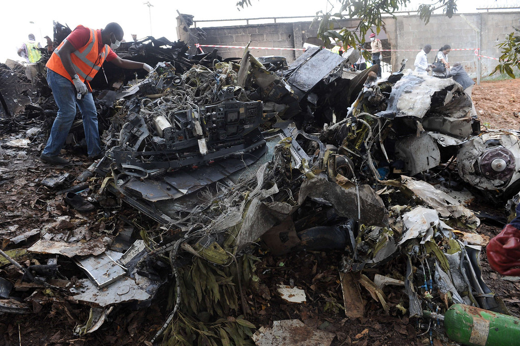 . A man looks at the wreckage of an Associated Airlines plane that crash-landed at Sahara Airport shortly after takeoff in Lagos on October 3, 2013. The Nigerian charter plane with 27 people on board suffered engine failure shortly after takeoff from Lagos, crash-landing near an airport fuel depot and killing at least nine people, officials said. AFP PHOTO/ PIUS UTOMI EKPEI /AFP/Getty Images