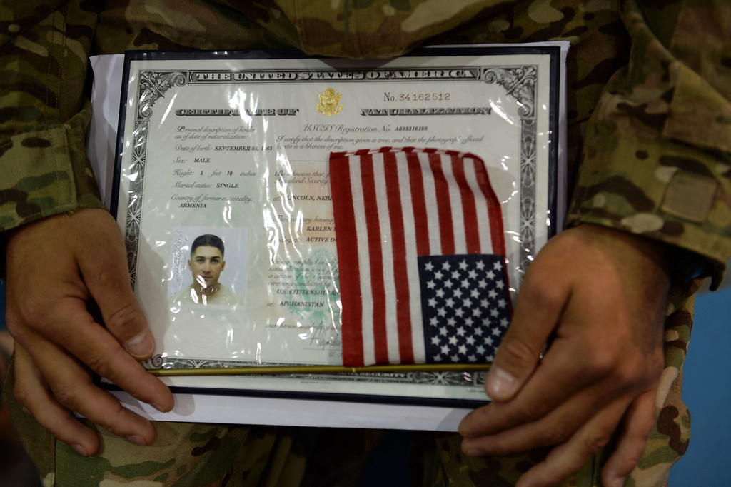 . A US soldier holds his certificate as he and others attend a naturalisation ceremony at the US base in Bagram, north of Kabul, on July 4, 2013. More than 30 US service members received their American citizenship in a naturalisation Ceremony at the Bagram airbase on July 4. The Naturalisation ceremony, held on the US Independence Day, is the final step in becoming a US citizen for these service members and recognises their sacrifice, contributions, and patriotism to the United States of America. SHAH MARAI/AFP/Getty Images
