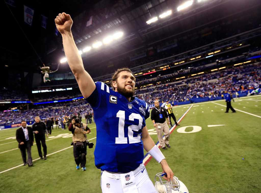 . INDIANAPOLIS, IN - JANUARY 04: Quarterback Andrew Luck #12 of the Indianapolis Colts celebrates after defeating the Kansas City Chiefs 45-44 in a Wild Card Playoff game at Lucas Oil Stadium on January 4, 2014 in Indianapolis, Indiana.  (Photo by Rob Carr/Getty Images)