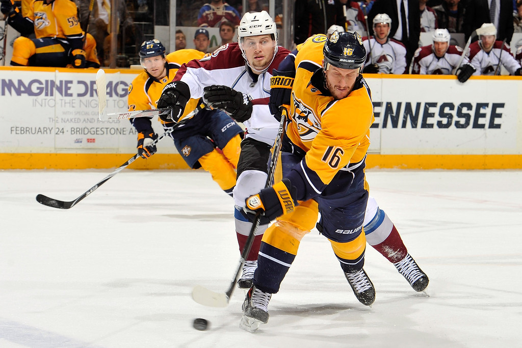 . NASHVILLE, TN - JANUARY 18: Rich Clune #16 of the Nashville Predators fires a shot into the offensive zone against the Colorado Avalanche  at Bridgestone Arena on January 18, 2014 in Nashville, Tennessee.  (Photo by Frederick Breedon/Getty Images)