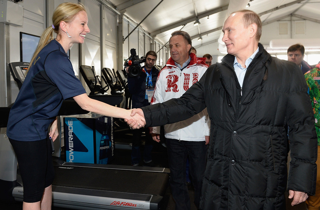 . Russian President Vladimir Putin (R) shakes hands with Galit Chait, coach of Japan\'s figure skating team, while visiting the Olympic village in Sochi on February 5, 2014, two days ahead of the opening ceremony for the Winter Olympics. AFP PHOTO / POOL / PASCAL LE SEGRETAIN/AFP/Getty Images