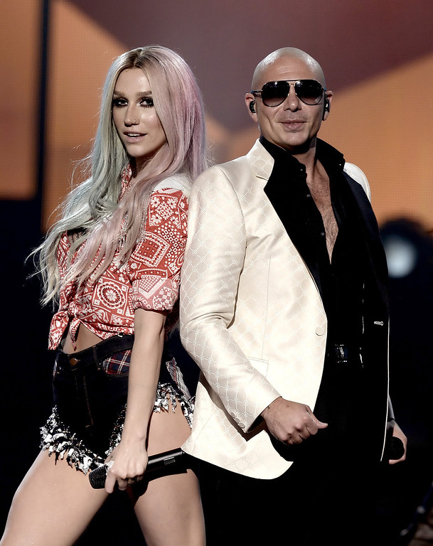 . Singers Ke$ha (L) and Pitbull perform onstage during the 2013 American Music Awards at Nokia Theatre L.A. Live on November 24, 2013 in Los Angeles, California.  (Photo by Kevin Winter/Getty Images)