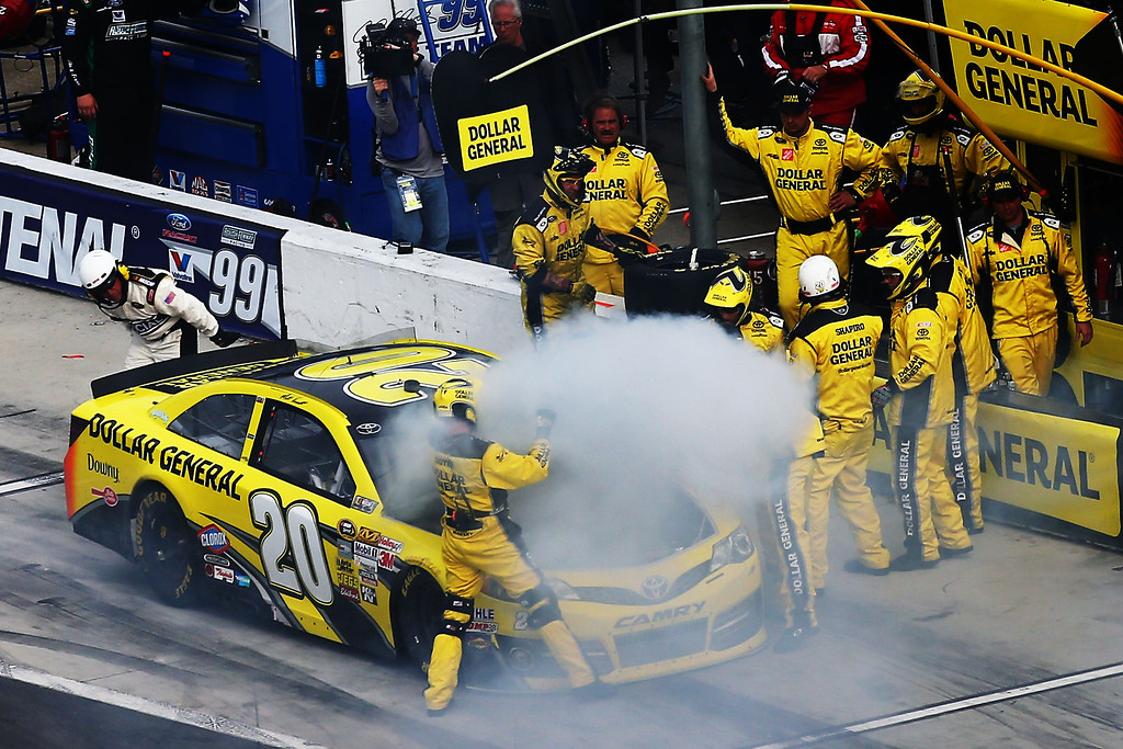 . Matt Kenseth, driver of the #20 Dollar General Toyota, pits after a malfunction during the NASCAR Sprint Cup Series Daytona 500 at Daytona International Speedway on February 24, 2013 in Daytona Beach, Florida.  (Photo by Jonathan Ferrey/Getty Images)