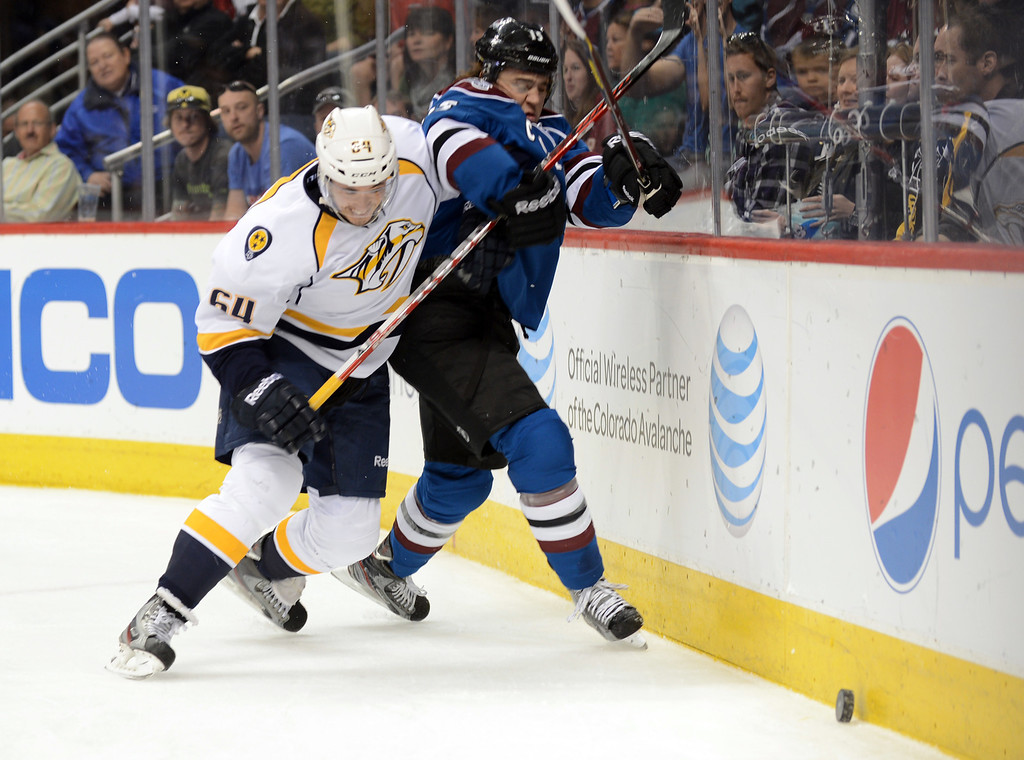 . Victor Bartley of Nashville Predators (#64), left, checks PA Parenteau of Colorado Avalanche (#15) in the 1st period of the game at Pepsi Center. Denver, Colorado. March 30, 2013. (Photo By Hyoung Chang/The Denver Post)