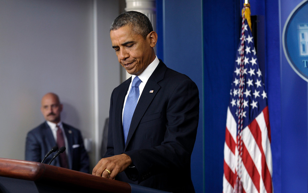 . President Barack Obama prepares to make a statement on the ongoing budget battle from the Brady Press Briefing Room at the White House in Washington, Monday, Sept. 30, 2013. Obama is ramping up pressure on Republicans to avoid a post-midnight government shutdown. He says a shutdown would hurt the economy and hundreds of thousands of government workers. (AP Photo/Susan Walsh)
