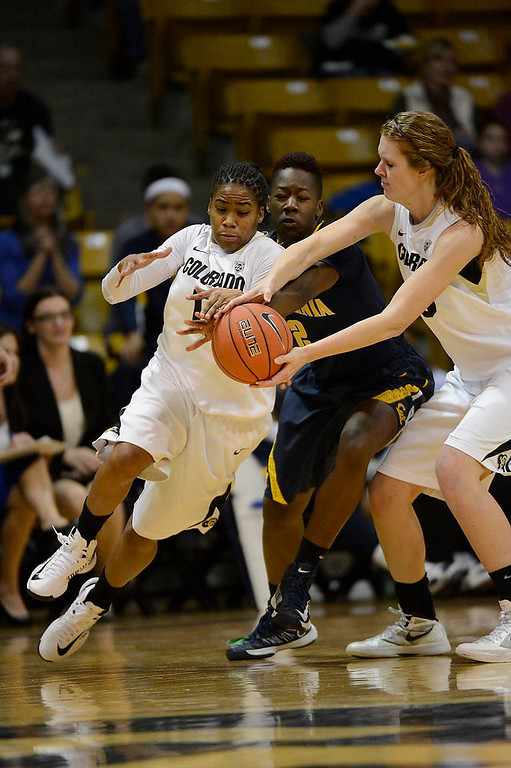 . Colorado Buffaloes center Rachel Hargis (40) hands the ball to Colorado Buffaloes guard Brittany Wilson (11) as California Golden Bears guard Afure Jemerigbe (2) reaches in during the first half Sunday, January 6, 2013 at Coors Events Center. John Leyba, The Denver Post
