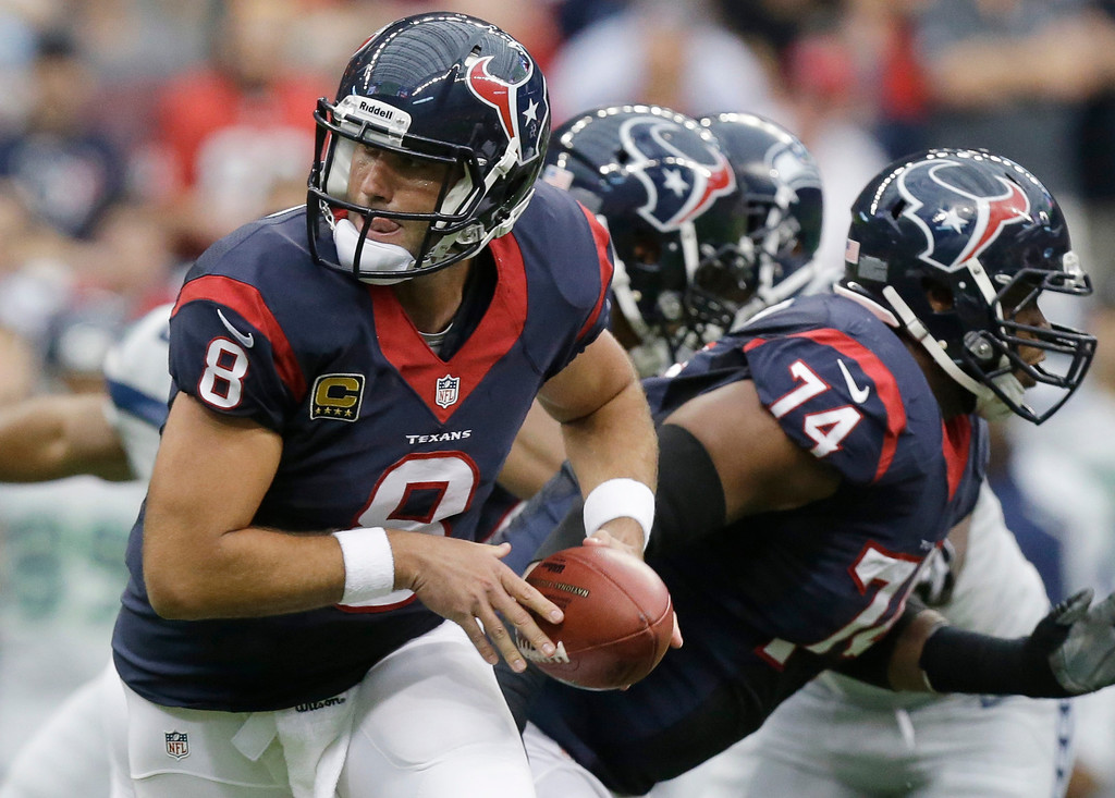 . Houston Texans\' Matt Schaub looks to hand the ball off during the first quarter an NFL football game against the Seattle Seahawks, Sunday, Sept. 29, 2013, in Houston. (AP Photo/Patric Schneider)
