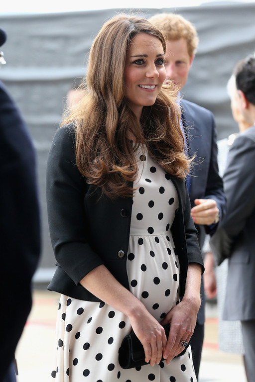 """. Britain\'s Kate the Duchess of Cambridge arrives with her husband Prince William, not pictured and his brother Prince Harry, rear right, to attend the inauguration of \""""Warner Bros. Studios Leavesden\"""" near Watford, approximately 18 miles north west of central London, Friday, April 26, 2013. (AP Photo/Chris Jackson, Pool)"""
