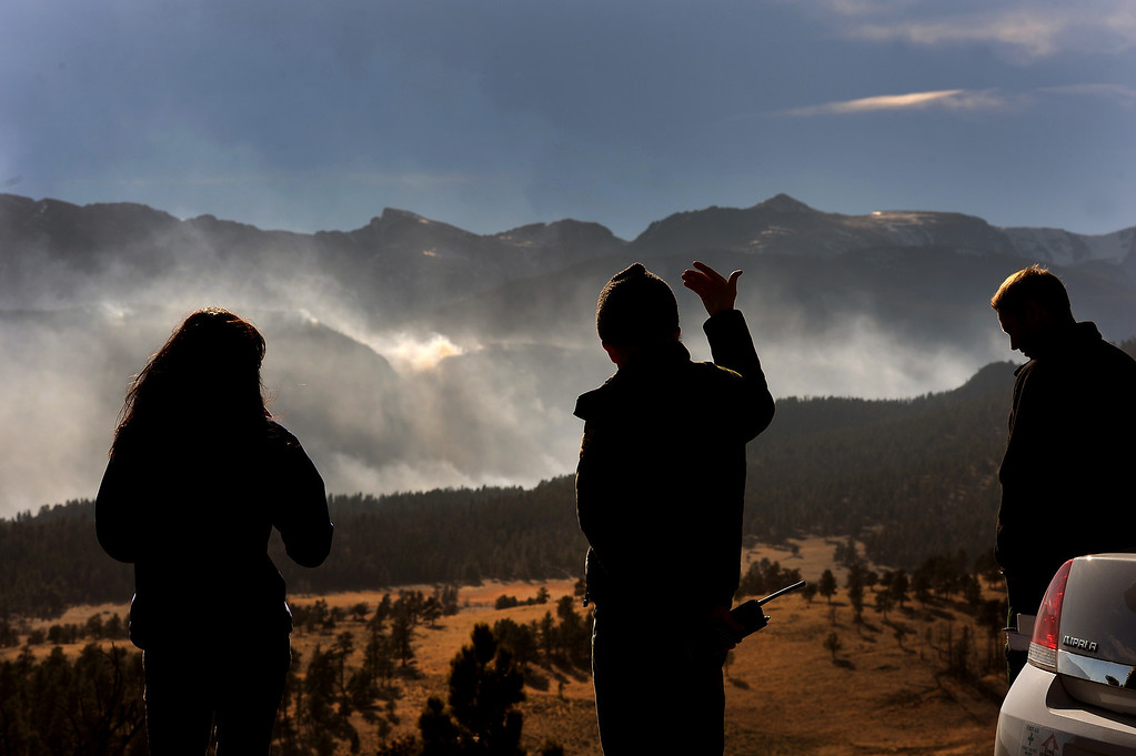 . Larry Frederick, middle, shows the direction of the wind on the Fern Lake Fire. Jake Brollier, another Public Information Officers on the Fern Lake Fire, is at right. Officials worry about winds kicking up later in the afternoon on December 2, 2012. The Fern Lake Fire, which has been burning in Rocky Mountain National Park since October, kicked up yesterday and forced the evacuation of hundreds of homes east of the fire. Helen H. Richardson, The Denver Post