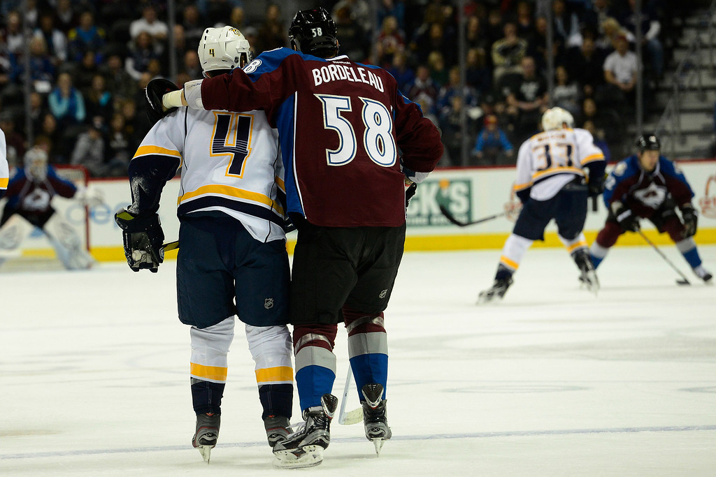 . Patrick Bordeleau (58) of the Colorado Avalanche puts his arm around Ryan Ellis (4) of the Nashville Predators after backing him down during the first period of action. The Colorado Avalanche take on the Nashville Predators at the Pepsi Center on February 18, 2013. (Photo By AAron Ontiveroz/The Denver Post)