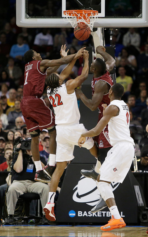 . New Mexico State�s DK Eldridge (1) and Tshilidzi Nephawe, right, go up for a rebound against San Diego State�s Josh Davis (22) during the first half of a second-round game of the NCAA men\'s college basketball tournament in Spokane, Wash., Thursday, March 20, 2014. (AP Photo/Young Kwak)