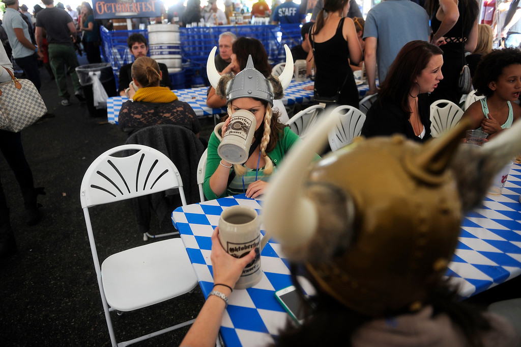 . DENVER, CO: Sept 28, 2013  Patty Webster, in town from New Jersey, takes a drink from her stein as she spends the afternoon at Denver\'s Oktoberfest with her friend Sherry Shibly.     (Photo By Erin Hull/The Denver Post)