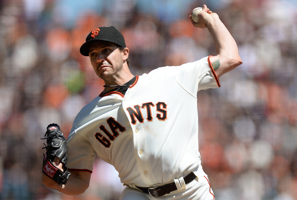 . Barry Zito #75 of the San Francisco Giants pitches against the Colorado Rockies in the first inning at AT&T Park on April 10, 2013 in San Francisco, California.  (Photo by Thearon W. Henderson/Getty Images)