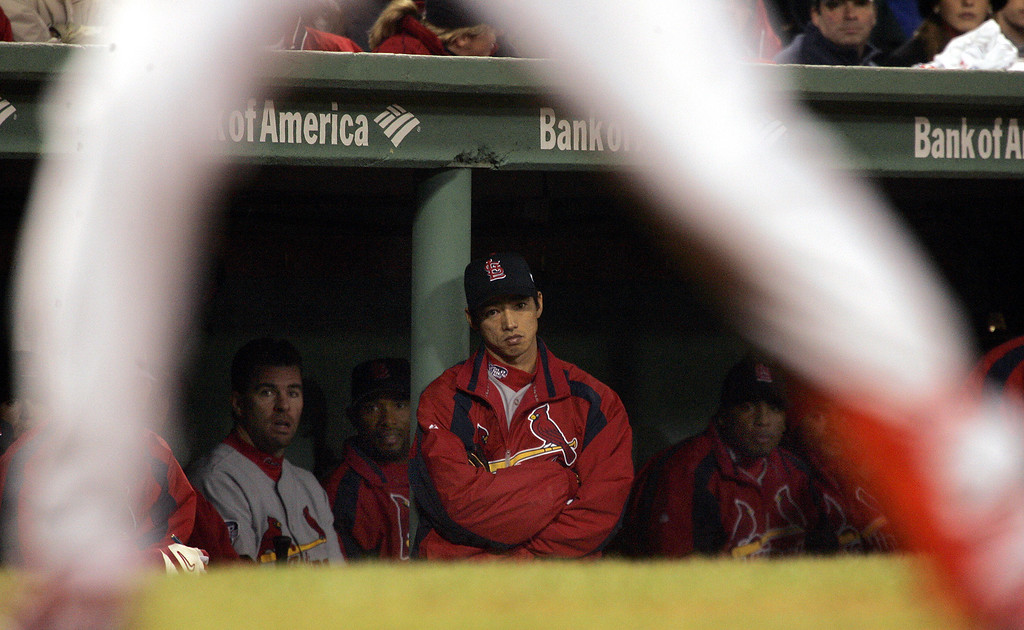 . St. Louis Cardinals\' So Taguchi, center, watches eighth inning action from the dugout during Game 2 of the World Series  in Boston, Sunday, Oct. 24, 2004.  (AP Photo/Elise Amendola)