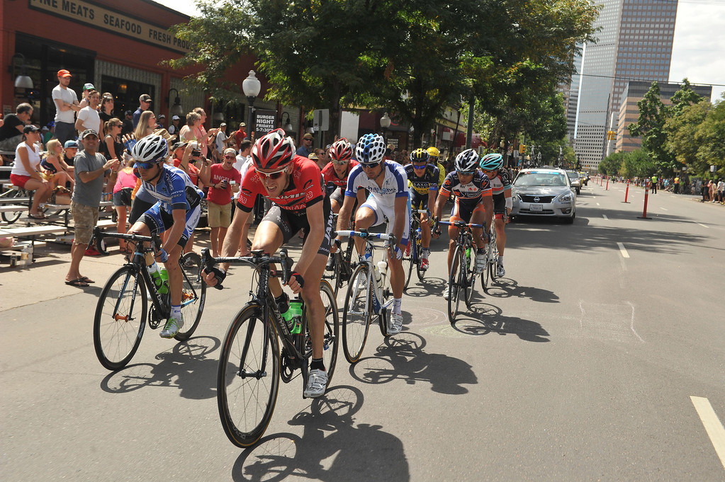 . Cyclists ride on 17th street during the 75-mile 7th stage of the 2013 USA Pro Challenge race in Denver, Colorado on August 25, 2013. (Photo by Hyoung Chang/The Denver Post)