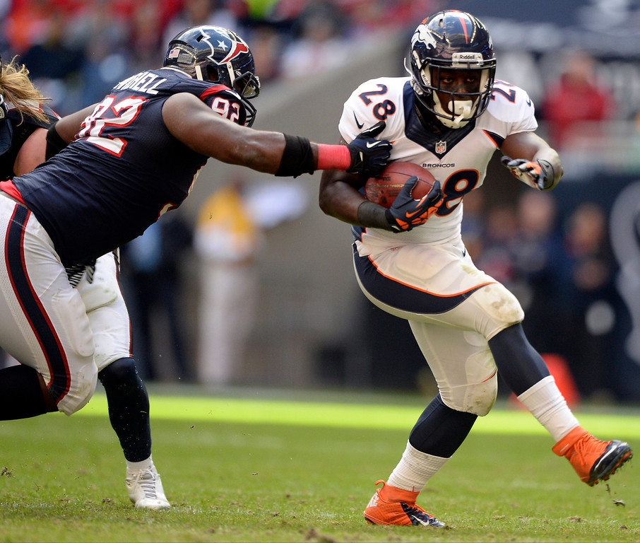 . Denver Broncos running back Montee Ball (28) picks a big gain before he is caught by Houston Texans nose tackle Earl Mitchell (92) during the fourth quarter December 22, 2013 at Reliant Stadium. (Photo by John Leyba/The Denver Post)