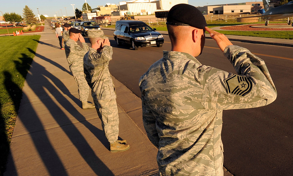 . Military personnel salute as a hearse carrying the casket of staff sergeant Liam Nevins drives by.  Military officials brought the body of special forces staff sergeant Liam Nevins, 32, home from Dover AFB September 30, 2013 at Buckley AFB. Nevins, of Denver, was killed two weekends ago in Afghanistan.  (Photo by John Leyba/The Denver Post)             Military personnel line the street salute as the hearse carrying the casket of staff sergeant Liam Nevins passes by