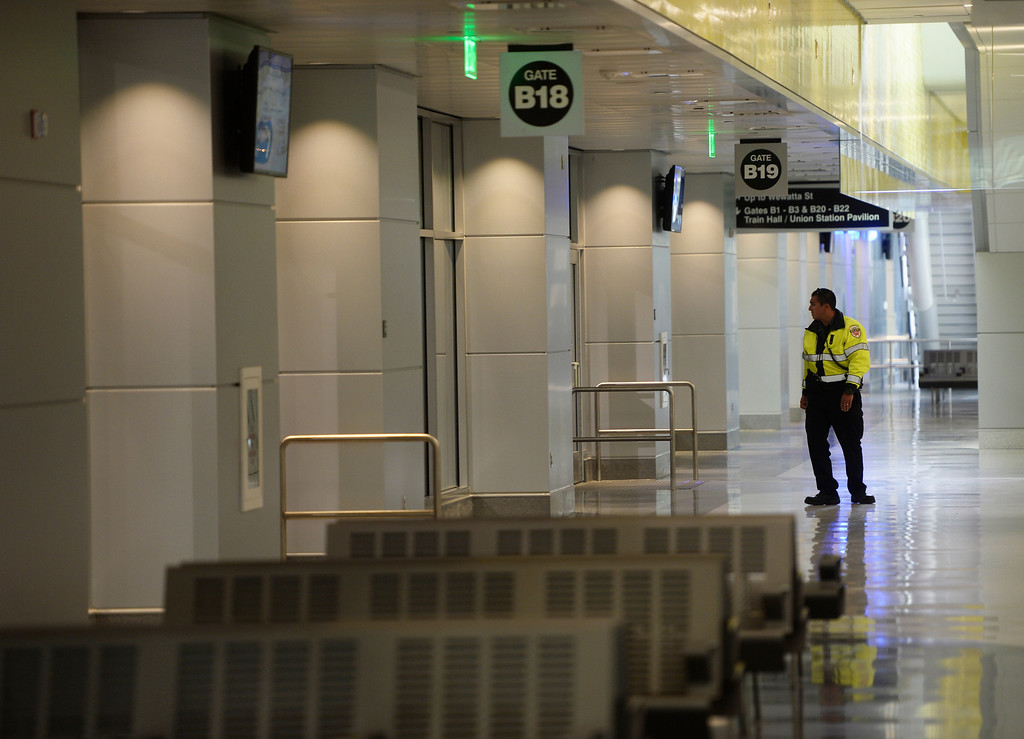 . DENVER, CO. - APRIL 25: A security officer checks gates at the new Underground Bus Concourse at the Union Station Transit Center during a media tour Friday morning, April 25, 2014. The transit center is scheduled to open May 11, 2014. (Photo By Andy Cross / The Denver Post)